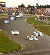 (front to rear) Tommy Kendall and Wayne Taylor (both driving an Intrepid RM-1) leads eventual winner Davy Jones (Jaguar XJR-16) and Chip Robinson, followed by Geoff Brabham (both in Nissan NPT-91), Raul Boesel (XJR-16) and James Weaver (Porsche 962) in the Nissan Grand Prix of Ohio, at Mid-Ohio Sports Car Course, 1991