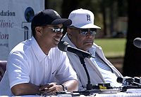 Tiger and his father Earl Woods at a press conference at Fort Bragg