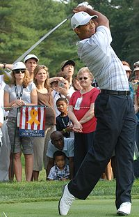 Tiger Woods drives the ball down range at the inaugural Earl Woods Memorial Pro-Am Tournament, part of the AT&T National PGA Tour event, July 2007.