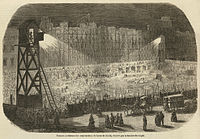 Enormous public works projects reconstructed the center of Paris. Here, work to extend the Rue de Rivoli continues at night by electric light (1854).