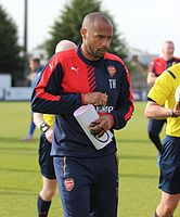 Henry as coach of Arsenal under 19s in September 2015