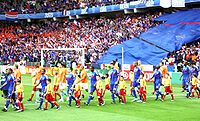 Henry (in blue, fourth from right) enters the field with France in their Euro 2008 game against the Netherlands
