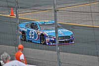 Almirola racing at New Hampshire Motor Speedway in 2015