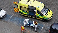 Ambulance workers in Brussels wearing PPE during an intervention.