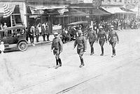 Troops returning from WW I march through Columbia, April 1919