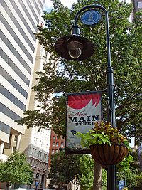 """A downtown lightpost banner heralds Columbia's """"New Main Street"""" as part of an effort to reinfuse life and vitality into Main Street."""