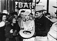 Marilyn Monroe and Gable with Eli Wallach and Montgomery Clift (in the background) in The Misfits (1961)