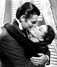 Gable and Vivien Leigh strike an amorous pose in Gone with the Wind (1939)