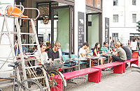 Café customers in Berlin Mitte using Wi-Fi devices