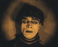 A scene from The Cabinet of Dr. Caligari starring Friedrich Feher—an example of an amber-tinted film