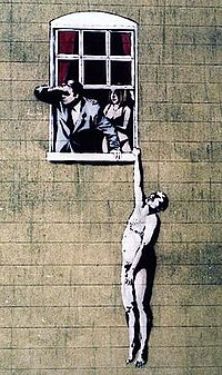Well Hung Lover, one of many Banksy artworks in the city, which has since been vandalised with blue paint (partially cleaned by the city council)