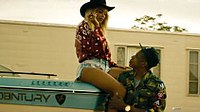 """Beyoncé and Jay-Z are seen touching whilst dressed in Western-style clothing in one of the many scenes of the """"Run"""" video, released in May 2014 to promote the tour."""