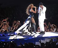 During the tour, both headliners sported multiple outfits. Beyoncé is seen wearing a black and white American flag dress, with a 16.4 feet long train.