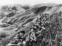 Australian soldiers resting in the Finisterre Ranges of New Guinea while en route to the front line.