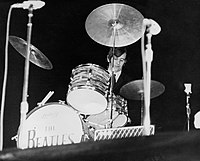 Starr performing with the Beatles in 1964