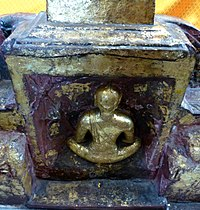 Relief on the base of a Buddhist statue