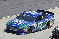 The 2013 NASCAR Sprint Cup Series Generation 6 version of the Ford Fusion as driven by Ricky Stenhouse Jr. at Martinsville Speedway.