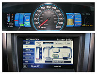 The Fusion Hybrid has digital panels to track eco driving (top), and current hybrid drive propulsion (bottom).