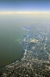 Aerial view from the north – the Menomonee River, Kinnickinnic River, and Milwaukee River are visible in the foreground; Wind Point in the background.