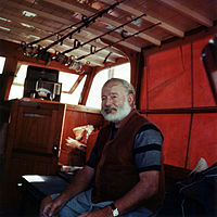 Hemingway in the cabin of his boat Pilar, off the coast of Cuba, c. 1950