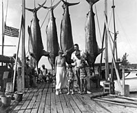 Ernest, Pauline, Bumby, Patrick, and Gregory Hemingway pose with marlins after a fishing trip to Bimini in 1935