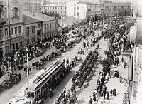 Polish troops enter Kyiv in May 1920 during the Polish–Soviet War in which Ukrainians sided with Poland against the Bolsheviks. Following the Peace of Riga signed on 18 March 1921, Poland took control of modern-day western Ukraine while Soviet forces took control of eastern Ukraine.