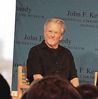 Kristofferson speaking at the 2014 PEN New England Song Lyrics Award ceremony held in Boston's John F. Kennedy Presidential Library and Museum
