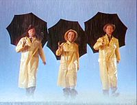 Gene Kelly, Reynolds, and Donald O'Connor during the Singin' in the Rain trailer (1952)