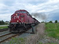 A westbound CP freight train pulls away from a passing siding after track clearance in Bolton, Ontario. It is headed by four GE AC4400CW locomotives (8627, 9615, 8629, and 8609).