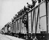 Strikers from unemployment relief camps climbing on boxcars as part of the On-to-Ottawa Trek, 1935.