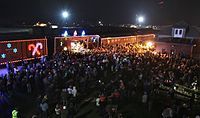 A crowd watches entertainers perform out of the CP Holiday Train