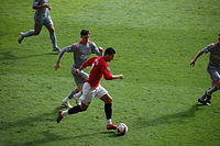 Ronaldo in his final season with Manchester United playing in a Premier League game against Liverpool