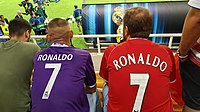 Fans of Real Madrid (left; Ronaldo's then current club) and Manchester United (right; Ronaldo's former club) wearing Ronaldo's No. 7 jersey at the 2017 UEFA Super Cup