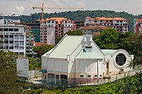 The Jesselton Freemason Hall on top of a hill in the city.