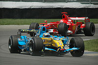 Alonso battling with Michael Schumacher at the 2006 United States Grand Prix