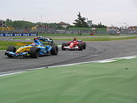 Alonso defended his lead from Michael Schumacher for the last thirteen laps, to take victory in the 2005 San Marino Grand Prix.
