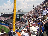The foul pole, upper deck, and the bleachers.