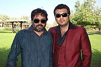 Ajith with art director M. Prabhaharan on location while filming Aasal