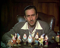 A 1937 image of Walt Disney (with figurines of the Seven Dwarfs) in his office at the former Hyperion studio. The office later became part of the Shorts Building on the Burbank lot