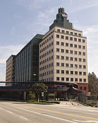 The ABC Studios building on the Walt Disney Studios Riverside Drive property in Burbank, California. The blue pedestrian overpass seen in the lower left connects it to the larger Buena Vista lot.