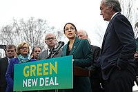 Ocasio-Cortez speaks on a Green New Deal in front of the Capitol Building in February 2019.