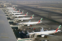 A row of Boeing 777-300s and -300ERs at Dubai International Airport operated by Emirates, the largest 777 customer.