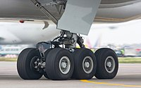The six-wheel undercarriage of a Boeing 777