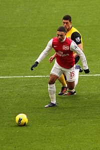 Oxlade-Chamberlain (in red shirt) playing for Arsenal in 2012