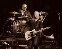 During his tenure with the E Street Band, Weinberg's gaze remains locked on Springsteen throughout each show.