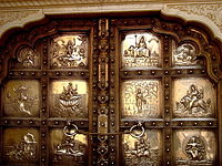 Embossed double leaf silver door entry into the Sila Devi temple