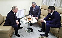 Nurmagomedov and his father meeting Russian President Vladimir Putin four days after his win against McGregor