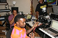 West in the studio in 2008, accompanied by mentor No I.D. (left)
