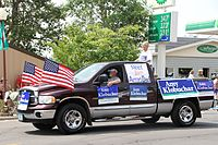 Klobuchar's father, Jim, and supporters campaigning for Klobuchar as U.S. senator, Tower, Minnesota, July 4, 2012