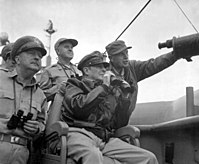 General Douglas MacArthur, UN Command CiC (seated), observes the naval shelling of Incheon from USS Mt. McKinley, 15 September 1950
